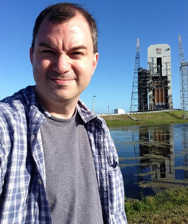 The writer, Travis K. Kircher, posed in front of the Delta IV Heavy rocket -- along with the Orion capsule -- two days before it launched.
