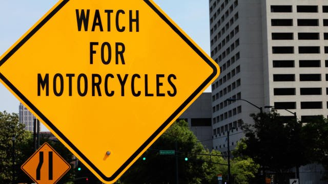 """A """"Watch for Motorcycles"""" sign in downtown Atlanta. Courtesy: Allstate"""