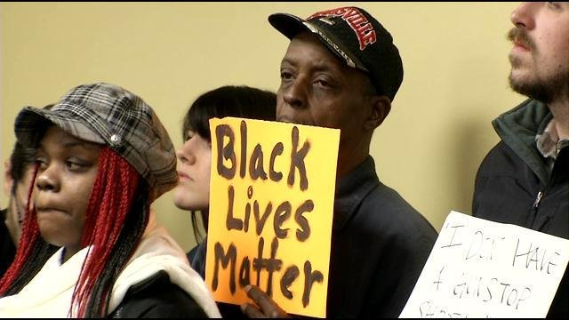 One attendee held a sign expressing concerns over racial injustices both local and national.