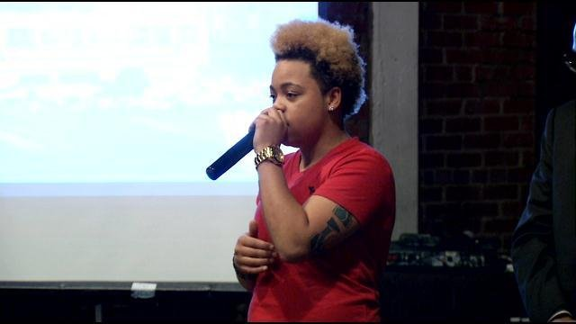 Sabrina Webb speaks to the crowd Thursday night, remembering her cousin Michael Brown.