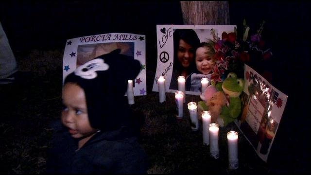 A vigil was held Sunday night for Porcia Mills, who was stabbed to death in her apartment Friday.