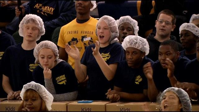 Students celebrate as Shawnee Principal Dr. Houston Barber announces the final total of 104,000 meals.