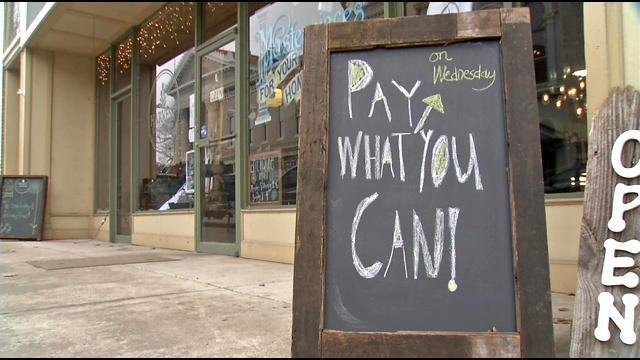 The blackboard outside The Harvest Cafe in Shelbyville is a perplexing sight at first, but a welcome welcome message to many.
