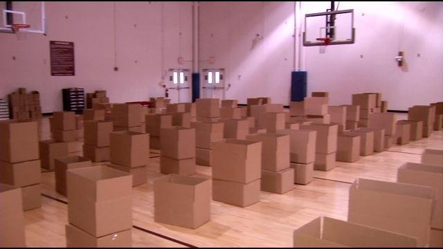 The police department and the community work together to fill these boxes with food.