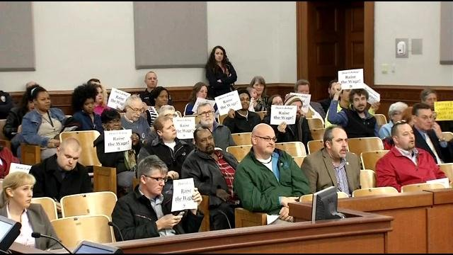 Minimum wage supporters at the Louisville Metro Council in December 2014