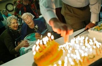 AP Photo/The Star Tribune, Richard Tsong-Taatarii). This Oct. 12, 2014 photo shows Anna Stoehr, center, celebrating her 114th birthday at Green Prairie Place senior apartments in Plainview, Minn. Stoehr, one of Minnesota's oldest residents, died Sunday.