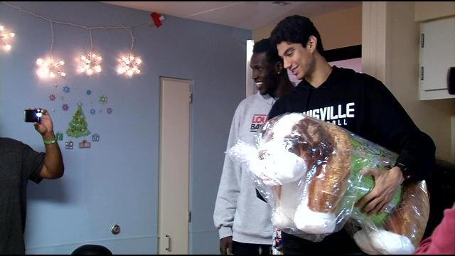 Mangok Mathiang and Anas Mahmoud helped distribute toys to sick children at Kosair Children's Hospital for an early Christmas surprise.
