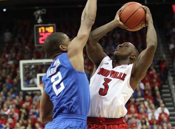 Louisville's Chris Jones tries to shoot over Aaron Harrison of Kentucky.