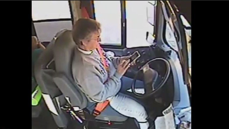 Surveillance video obtained by WDRB shows bus driver Linda Boldery texting while driving a school bus, with students on board.