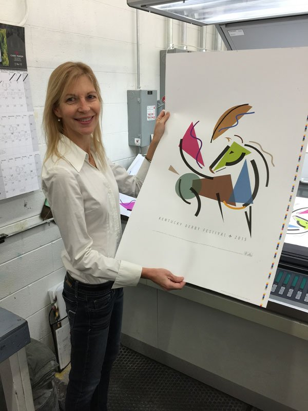 Artist Karen Boone with the limited edition 2015 Kentucky Derby Festival poster. (Source: Kentucky Derby Festival)