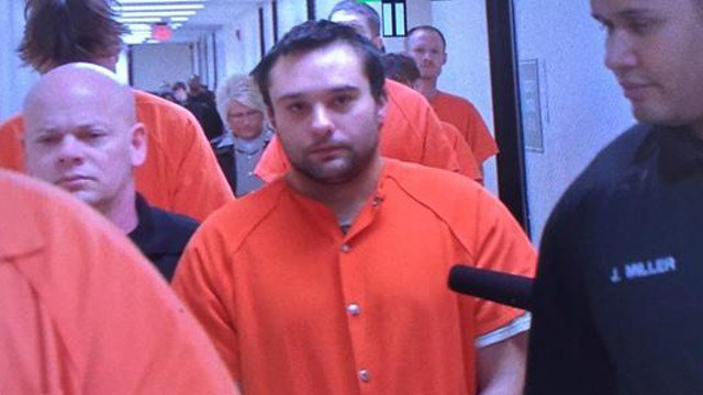 """Christopher Bruck walks into court Wednesday Jan. 7, 2015, telling reporters """"I didn't hurt him."""""""