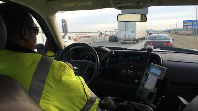 Safe Patrol officer Samuel Cromity pulls over to assists a stranded motorist.