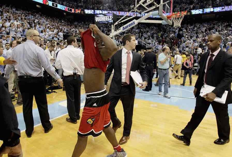 Chris Jones walks off the court after Louisville's 72-71 loss at North Carolina. AP photo.
