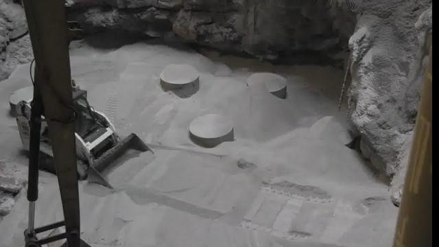 Remote controlled bobcats were used to fill in the sinkhole with tons of limestone.