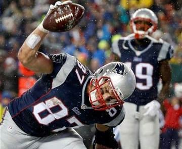 New England Patriots tight end Rob Gronkowski (87) spikes the ball after catching a five-yard touchdown pass during the second half of the NFL football AFC Championship game against the Indianapolis Colts Sunday, Jan. 18, 2015. (AP Photo/Elise Amendola)