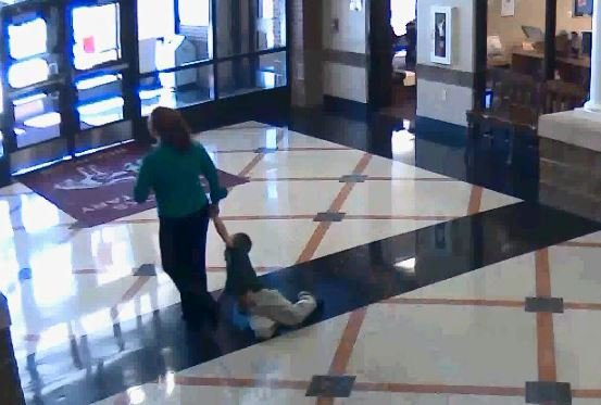 Ashley Silas dragging child on Oct. 29, 2014 (Bullitt County Public Schools)