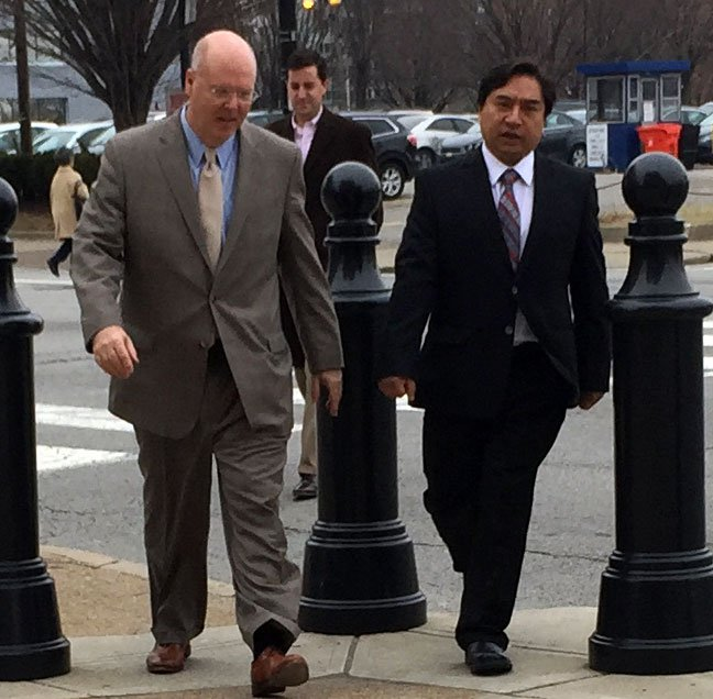 Dr. Jaime Guerrero (at right) walked into the federal courthouse, flanked by his attorney, Scott Cox.