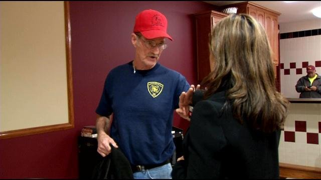 Former SE Bullitt Fire Chief Julius Hatfield, confronted by WDRB's Valerie Chinn in November 2014.