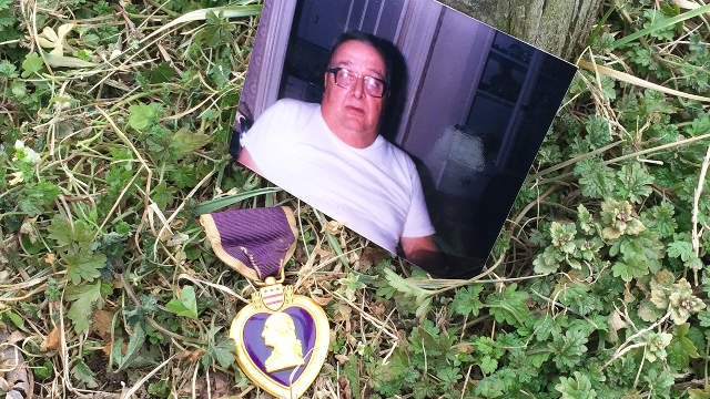 A photo of Homer Myers next to his Purple Heart.
