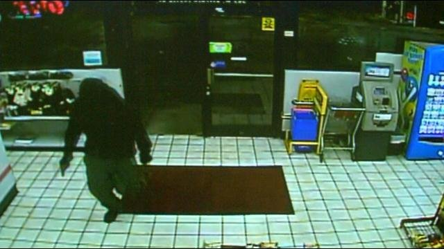 Surveillance video shared with WDRB News shows the suspect bursting through the doors.