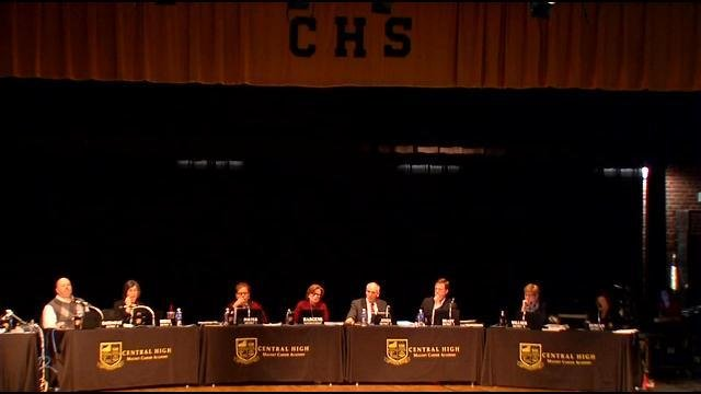The JCPS board seated at a table on the stage at Central High School Monday, February 23, 2015.