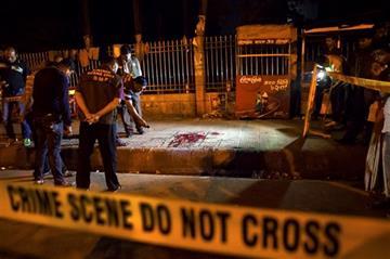 (AP Photo/Rajib Dhar). In this Thursday, Feb. 26, 2015, photo, Bangladeshi policemen investigate at the site of attack on Avijit Roy, in Dhaka, Bangladesh.