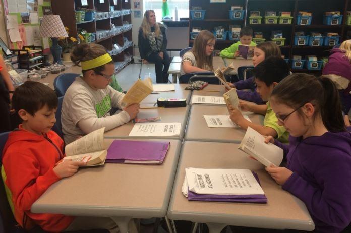 Fifth graders in Laurel Oskins' classroom read books on Feb. 27. 2015 (Photo by Toni Konz)