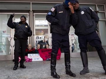 (AP Photo/Cliff Owen). Metropolitan D.C. Police officers stand-by as pro Palestine demonstrators, led by Code Pink, wearing Israeli Prime Minister Benjamin Netanyahu masks, protest in front of doors of the Washington Convention Center.