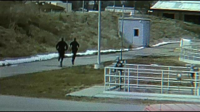 Surveillance footage shows officers running into the wastewater treatment facility when they heard the boy.