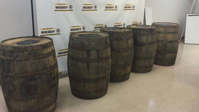 The stolen barrels of Wild Turkey bourbon recovered in a search.