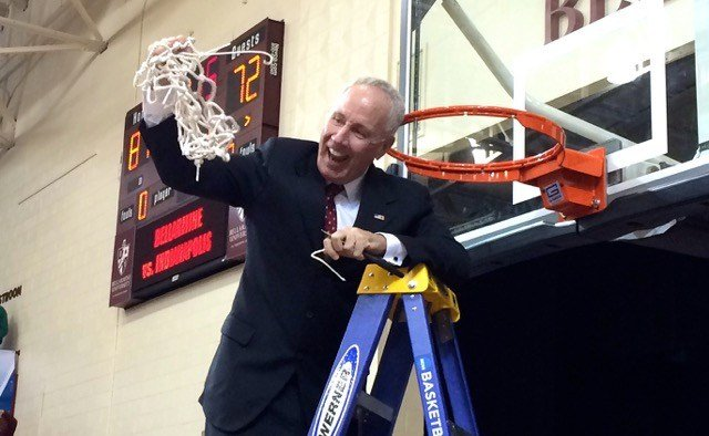 Bellarmine coach Scott Davenport cuts down the net after his team's regional title win over Indianapolis. (Eric Crawford photo)