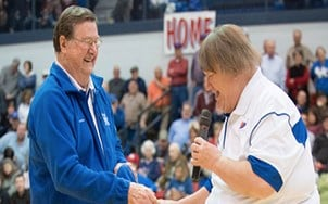 Ira Combs (right) shakes hands with former UK basketball coach Joe B. Hall.