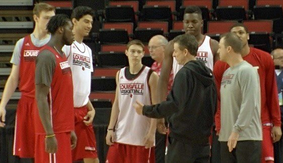 Rick Pitino talks with his players during Thursday's public shootaround at Key Arena in Seattle. WDRB photo by John Lewis.