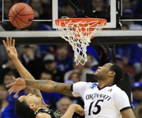 Cincinnati forward Jermaine Sanders tries to block a shot against Purdue. (AP Photo by Tim Easley.)