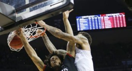 Willie Cauley-Stein dunked over Quadri Moore to put Kentucky ahead of Cincinnati to stay Saturday. (AP Photo)