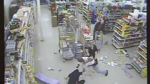 Surveillance video shows the man beating a Dollar General store employee Wednesday, March 25, 2015.