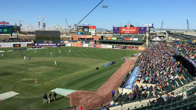 Fans kept to the sunlit areas of the stadium as temperatures hovered in the 40s on opening day for Louisville City FC.