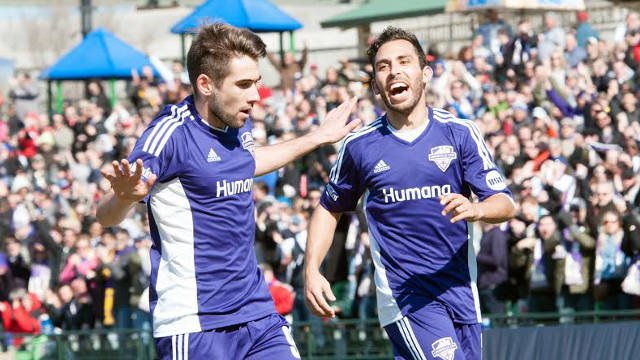 Charlie Adams (left) and Juan Guzman celebrate Adams' second half tally in Louisville City's home opener (Courtesy: Louisville City Football Club).
