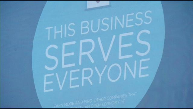 The stickers are popping up in the windows and doors at southern Indiana businesses as part of an anti-discrimination campaign.