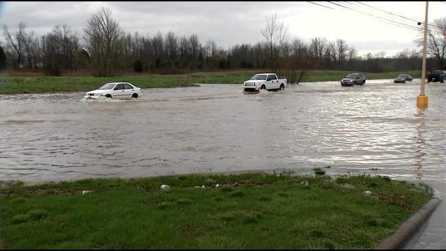 As water continued to pile up on roadways around Louisville, many drivers disregarded barriers and drove into the water on April 3, 2015.