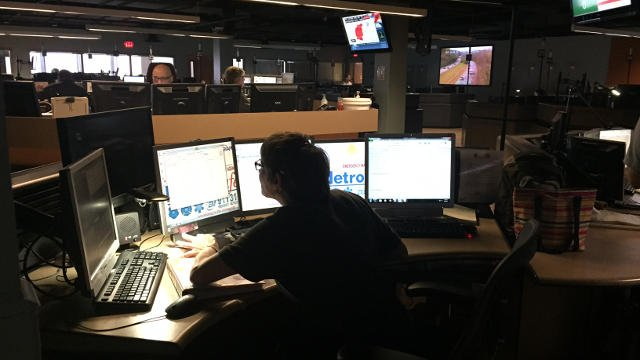 Two nurses work at the MetroSafe 911 call center among all the dispatchers and call takers.