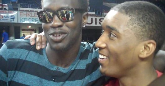 Louisville recruit Donovan Mitchell was congratulated by Mangok Mathiang after the Derby Classic.