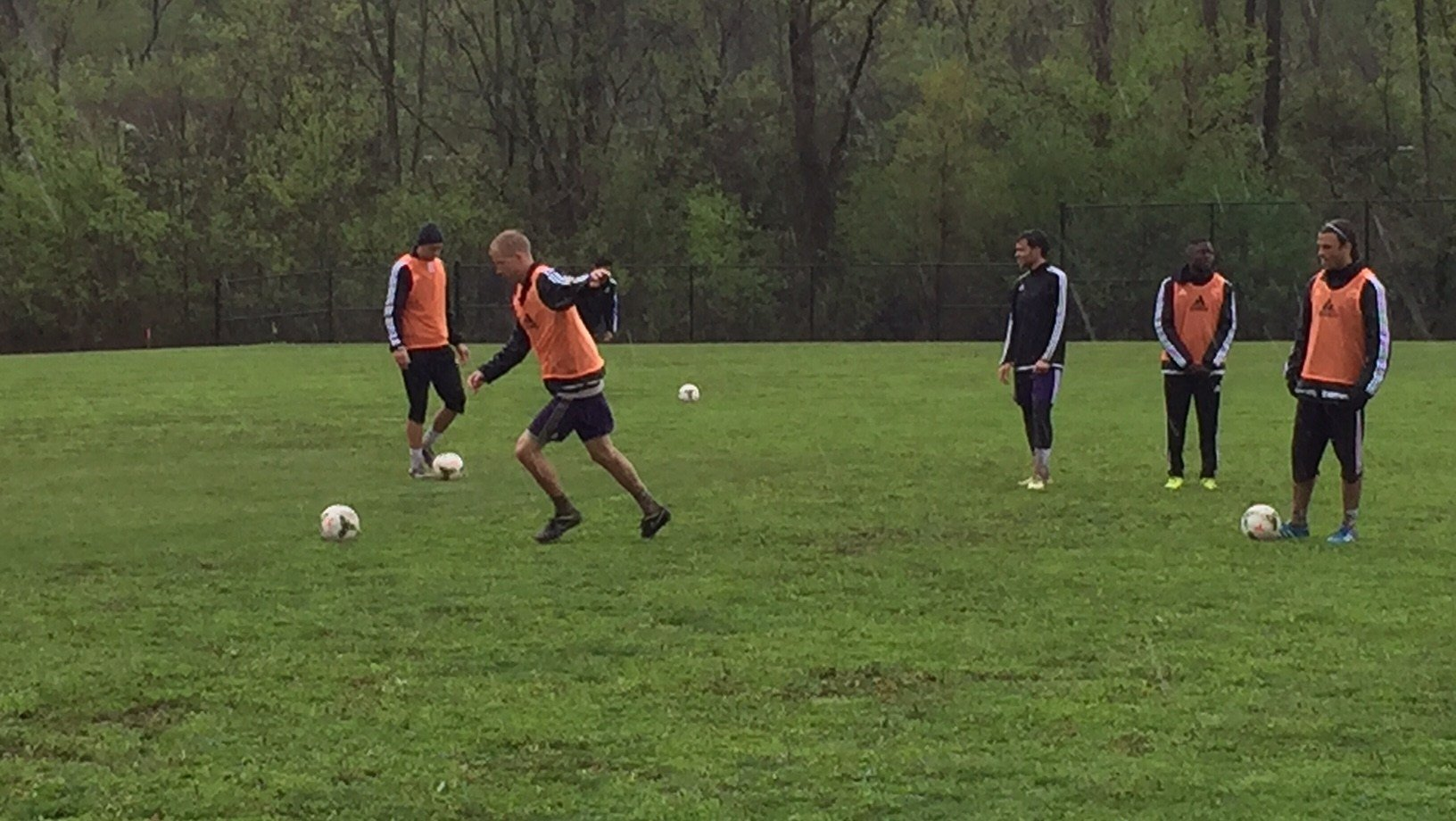 Louisville City players work through a rain-soaked shooting drill at the team's recently completed practice facility at Thurman Hutchins Park April 14, 2015.