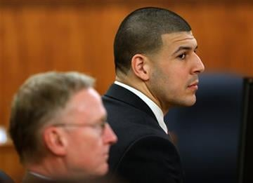 (David L. Ryan/The Boston Globe via AP, Pool). Former New England Patriots NFL football player Aaron Hernandez, right, sits besides his attorney Charles Rankin during deliberations in his murder trial, Tuesday, April 14, 2015.