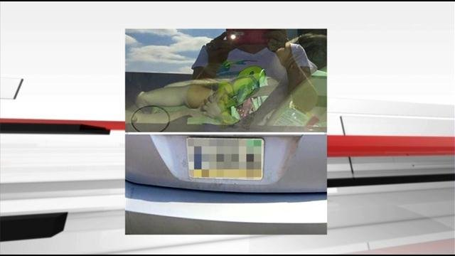 While waiting for police to respond to the scene, Rebecca Kemp took photos of the baby in the car and the license plate and shared them on social media.