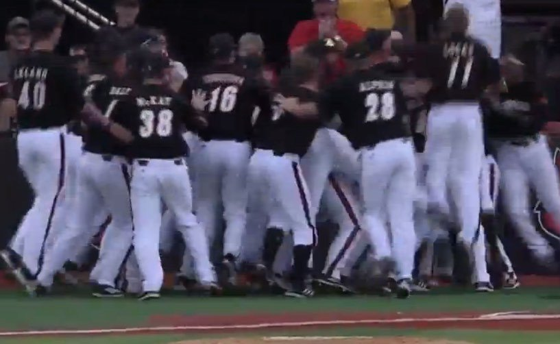 U of L celebrates after Corey Ray's walk-off steal of home. (U of L YouTube image)