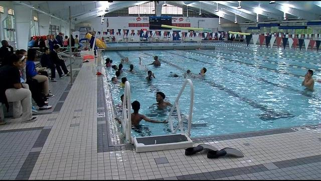 """Local middle school students hopped into the pool with five Olympic swimming champs on Monday as part of the """"Go for the Gold"""" program."""