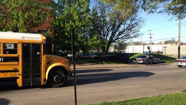 As upset parents looked on, a JCPS school bus picked up students for school just outside crime scene tape in front of the City View apartments. The suspect surrendered about an hour later.