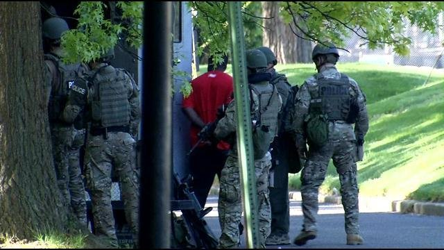 A suspect surrenders to police after barricading himself in an apartment in the 500 block of Quest Drive on April 23.