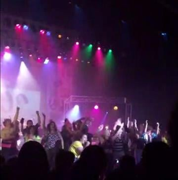 "(Zach Rader via AP). In this image from video provided by Zach Rader students from Westfield High School are on the stage during the grand finale of the concert dubbed ""American Pie"" Thursday April 23, 2015 just prior to the stage collapse."